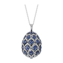 Fabergé Round White Diamonds and Round Blue Sapphires Zenya Egg Pendant