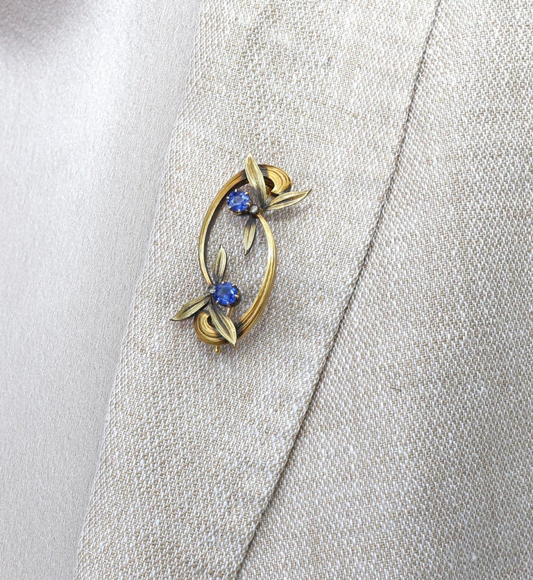 Russian Faberge Sapphire Floral Brooch Pin in Original Box. An extremely rare example of the famous Russian Jewelry House Faberge. Stamped in Cyrillic KF (Karl Faberge) 56 Gold Hallmark.  The work is simply outstanding! The leaves are so delicate