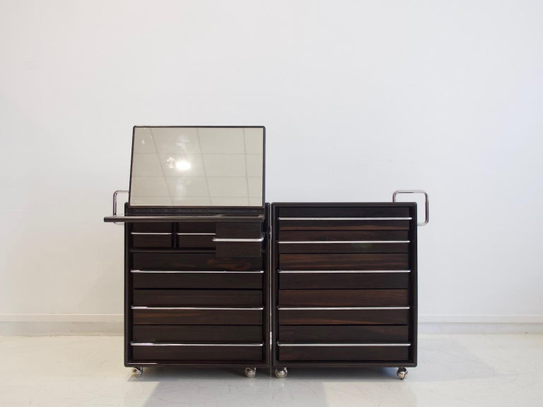 Chest of drawers/dressing table made of two adjustable compartments hinged together, which can be opened and closed as demonstrated on the photos. Made of solid wood and veneered plywood in some parts, handles in chromed steel. Produced by Bernini