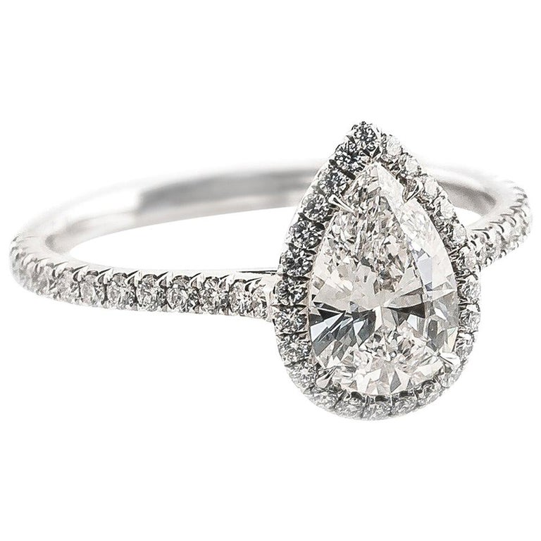 Fabricated Platinum .88 Carat D-VS1 Pear Shape Diamond Halo Engagement Ring For Sale