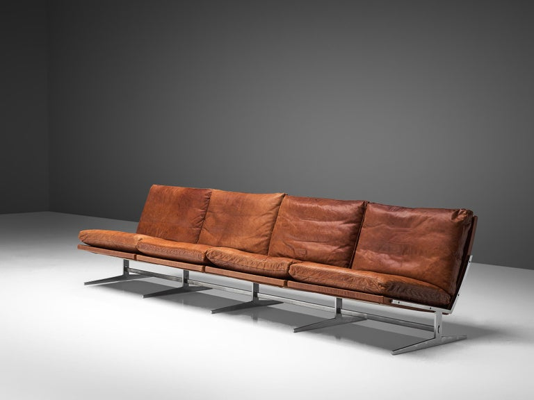 Preben Fabricius & Jørgen Kastholm, sofa model BO561, brushed steel and cognac leather, Denmark, 1962.   This modern slipper sofa is made out of steel and leather. Besides this slick and Minimalist design, the midcentury sofa is suprisingly