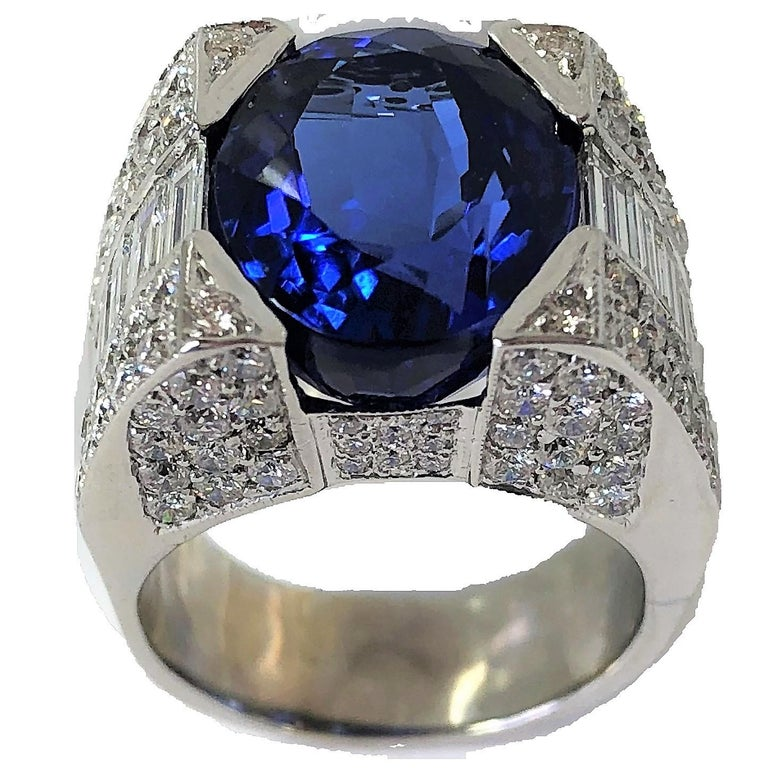 Contemporary 12.06 Carat Oval Tanzanite and Diamond Ring For Sale
