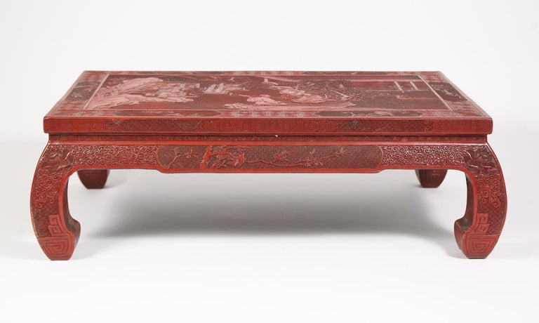 A Fabulous 19th century Chinese carved cinnabar low table beautifully hand carved and detailed depicting a palace scene with people seated in the palace gardens playing traditional Chinese musical instruments. This table can be used as a perfect