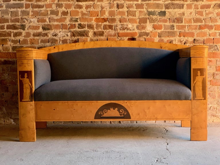 Antique Austrian Biedermeier sofa satin birch, 19th century circa 1830  Magnificent Austrian 19th century Biedermeier satin birch sofa circa 1830, the arched back and hinged top arms with storage compartments to both arms, over supports featuring