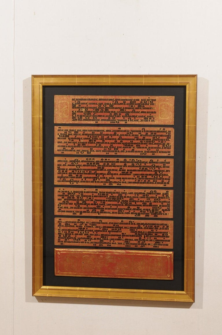 A fabulous collection of 19th century Buddhist manuscripts artistically displayed within custom frames. This collection of three framed wall art hangings each contain a section of a 19th century manuscripts written in Kammavaca, a sacred religious
