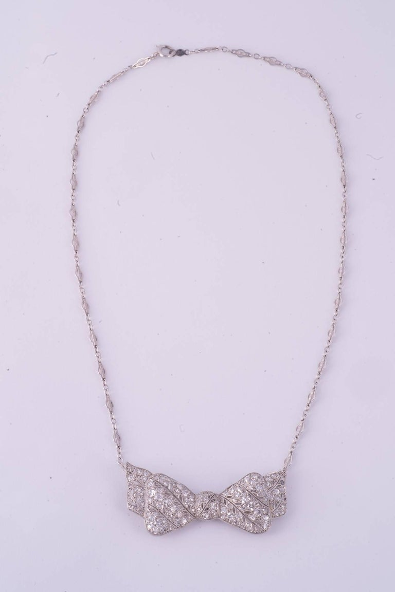 Art Deco Dimaond Bow Necklace. The there are 105 diamonds and they weigh approx. 5.05cts . the necklace is platinum. Chain comes off to wear as a brooch.