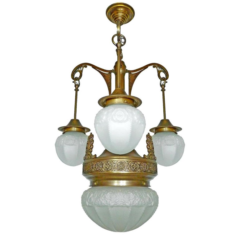 French Degué style Art Deco white frosted glass, 4-light chandelier/ brass 4 light bulbs (3 bulbs E14 40W + one bulb E27 60W) Good working condition Measures: Diameter 23.6 in / 60 cm Height 35.4 in / 90 cm Glass shades: 6 in (15 cm) / 6 in