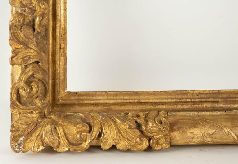 Fabulous Louis XIV period hand-carved giltwood frame - mirror with flower corners, France, late 17th-early 18th century. Sight size is: 61.5 cm x 61.5 cm Overall size is: 78 cm x 78 cm.