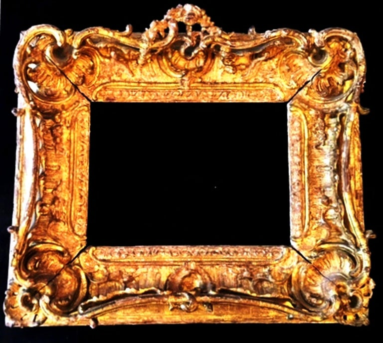 Fabulous Louis XV Period Frame, Mounted as Mirror, Rocaille Decors, France, 1750s Carved Giltwood Asymetrical decors of shells, garlands of flowers, etc.... Paris workshop Sight size is H: 24.5 cm x L: 35 cm Overall size is : H : 52 cm x L: 60