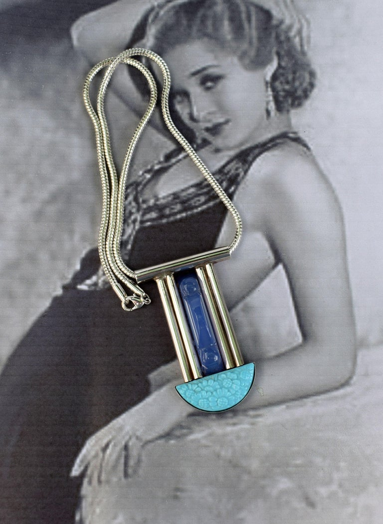 Fabulous French Modernist  Art Deco statement pendant necklace. This necklace is so so elegant and stylish, perfect for either a dressy evening or bohemian day wear. Features blue lapis carved centre accent with a blue Galalith 1930's vintage