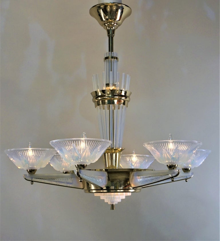 A stunning French polished bronze Art Deco six-arm chandeliers with opalescent glass arms and shades even the centre column adorned with opalescent glass. These chandelier has total of nine lights.