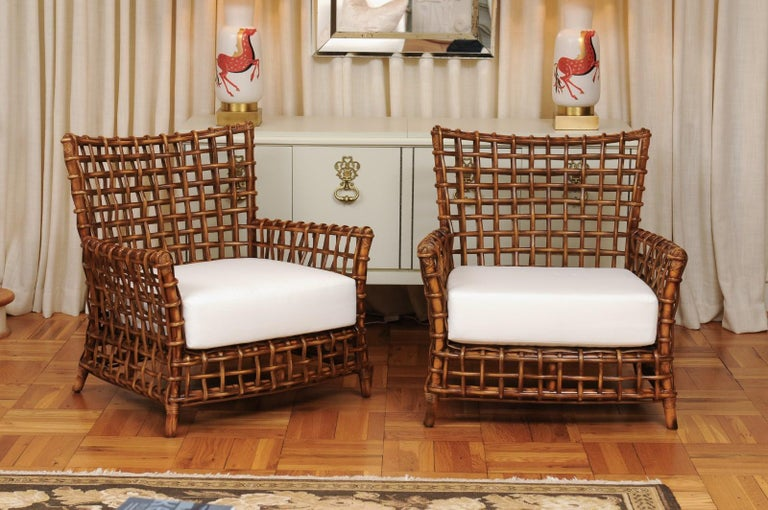 These magnificent club chairs are shipped as professionally photographed and described in the listing narrative: Meticulously professionally restored and installation ready. Expert custom upholstery service is available.  A fabulous pair of