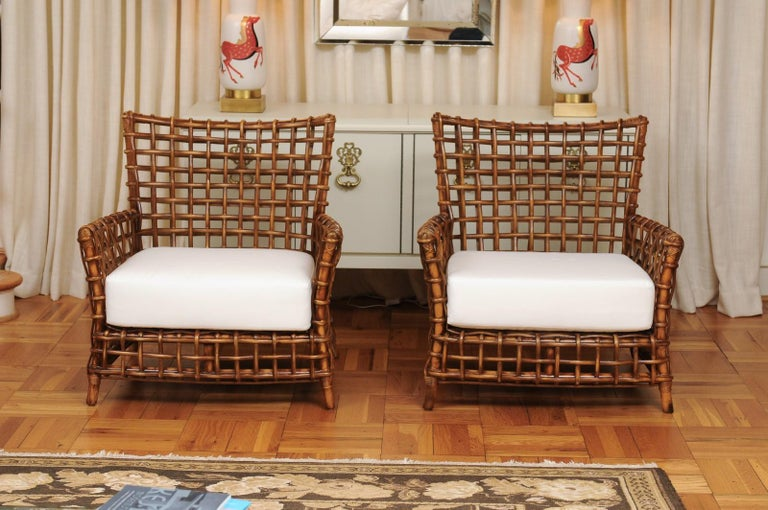 Late 20th Century Fabulous Pair of Caramel Rattan and Cane Club Chairs by McGuire, circa 1980 For Sale