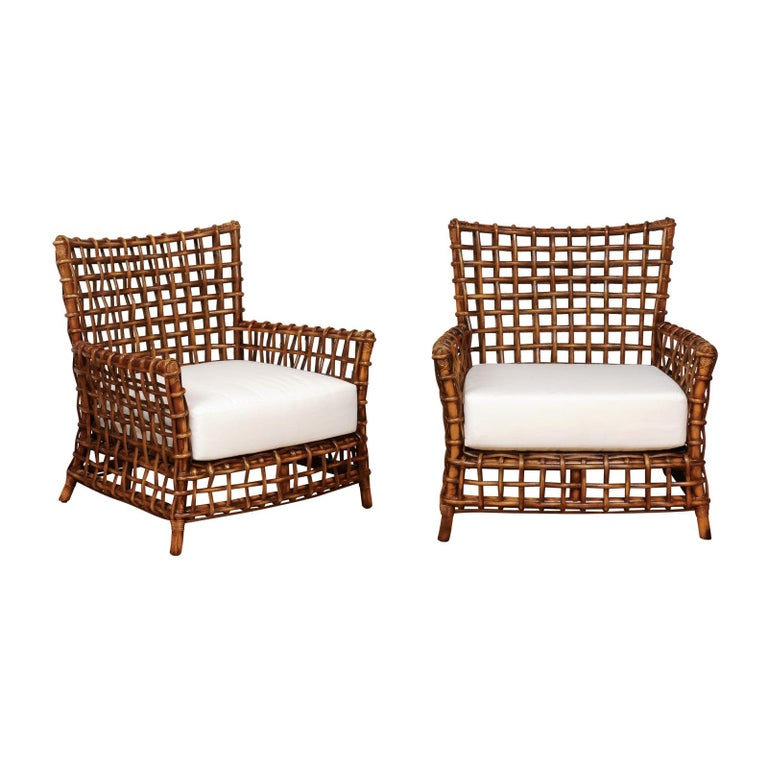 Fabulous Pair of Caramel Rattan and Cane Club Chairs by McGuire, circa 1980 For Sale