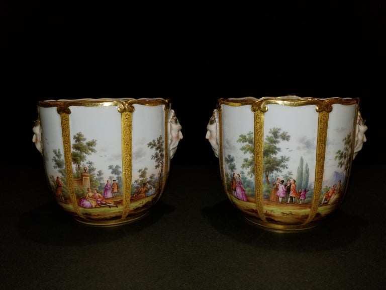 A fabulous pair of Meissen Porcelain glass coolers/cachepots. This exceptional pair of exquisitely hand-painted Meissen Porcelain glass coolers are each painted with panels of figures in a landscape, which include harbor as well as equestrian