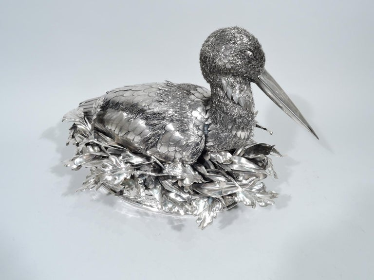 Fabulous quality silver bird. Made by Mario Buccellati in Milan, circa 1930s. Bird in tucked-in mode with wings close to body. Imbricated feathers heightened with engraving as well as bristly wire down. Head turned to side with long closed bill. A