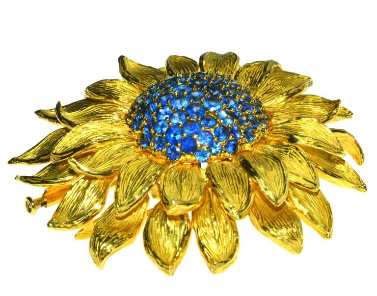 FabulousValentin Magro sunflower brooch with a gorgeous cluster of Ceylon sapphires in the center.  18K yellow gold bursting with beauty!
