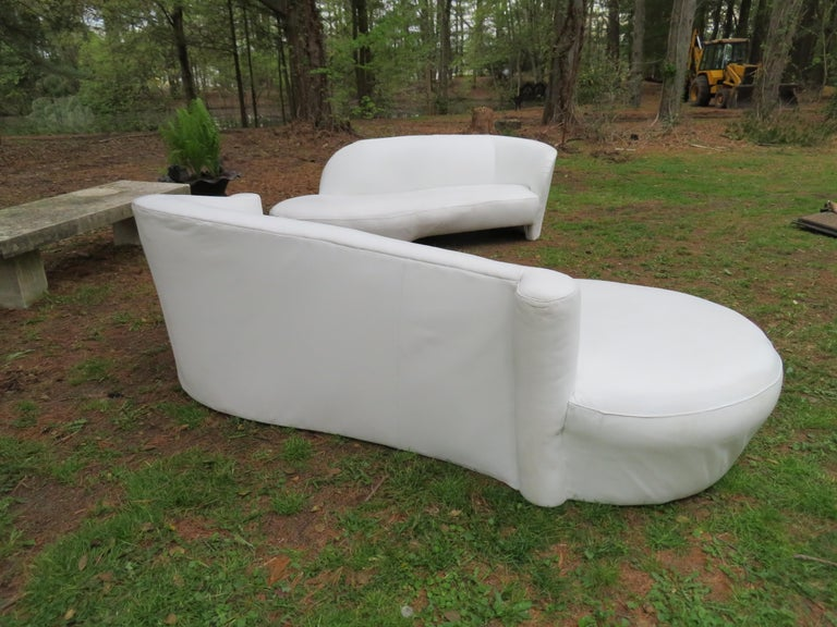Fabulous Vladimir Kagan scrolled arm white leather cloud sofa, circa 1980's. This sofa has been recently re-upholstered in a durable thick white leather and looks great. Check out the coordinating Kagan white leather sofa that we also have-they look