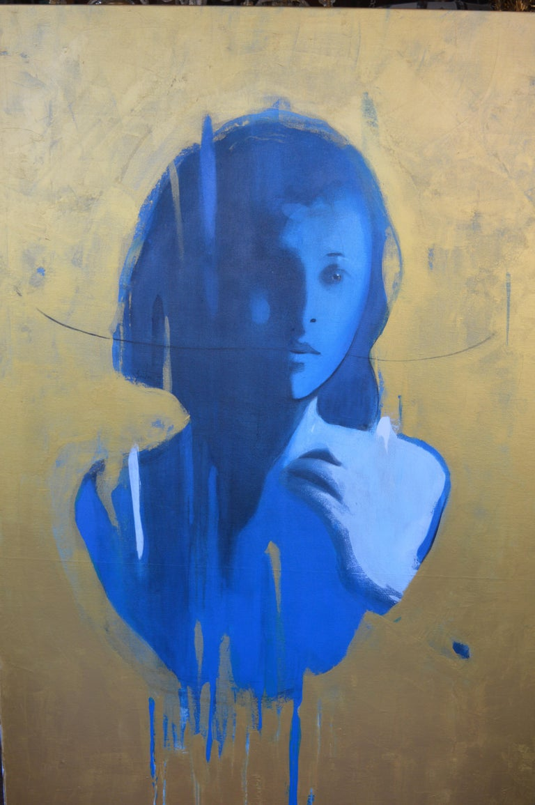 Face in blue is a mixed-media painting by Jorge Santos, signed on the back of the painting.