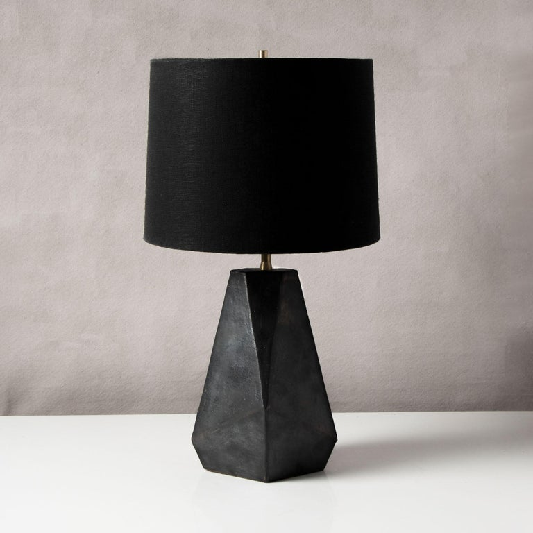 Inspired by midcentury Brutalist architecture, this tapered ceramic table lamp base combines clean geometric lines with the warmth and individuality inherent in handmade work. Each piece is assembled individually from flat sheets of clay, into a