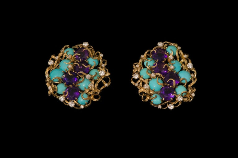 A pair of faceted amethyst, cabochon turquoise, diamond, and 18 karat gold clip on earrings.   The earrings are stamped ABJ, 750 and have London Hallmarks dated with letter