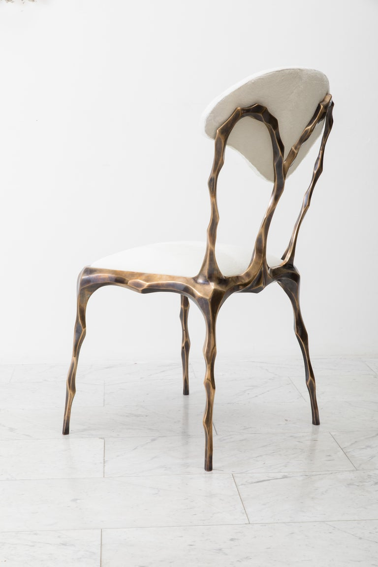 Taking inspiration from the twisting forms of seaweed and other natural materials, Haase hand-carves each element of his unique dining chair before casting it in his New York City Studio. The bronze components are then welded together by the artist