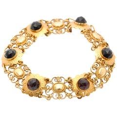 Faceted Garnets 14 Karat Yellow Gold Open-Worked Flower Link Bracelet