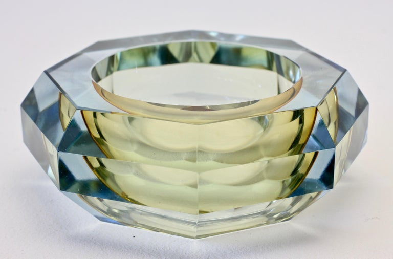 Large vintage Italian midcentury Murano multifaceted art glass bowl attributed to Mandruzzato, circa 1970s. The combination of amber toned and light blue tinted or clear 'Sommerso' cut-glass looks simply stunning.  The early work of Mandruzzato is