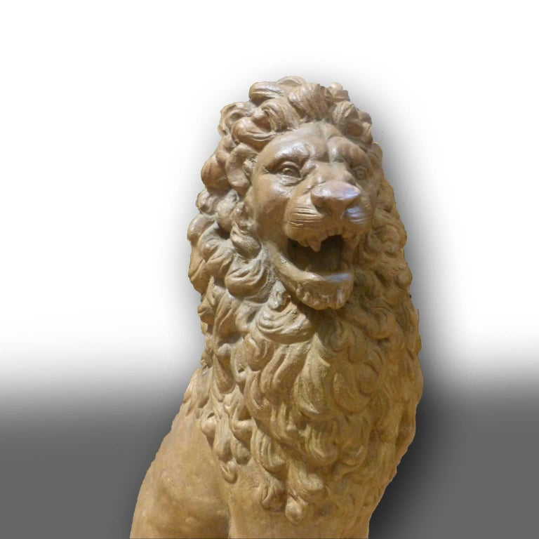Mid-19th Century Facing Pair of Early 19th Century Tuscan Terracotta Lion Sculptures For Sale