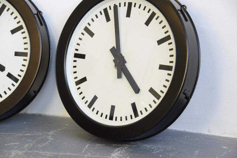 Factory Clocks By Bohmeyer, circa 1930s  - Price is per clock - Steel casing - Glass face - Steel dial - New quartz motors  - Takes 1x AA battery - Made by Bohmeyer, Halle - German ~ 1930s - 50cm wide x 8cm deep  Condition