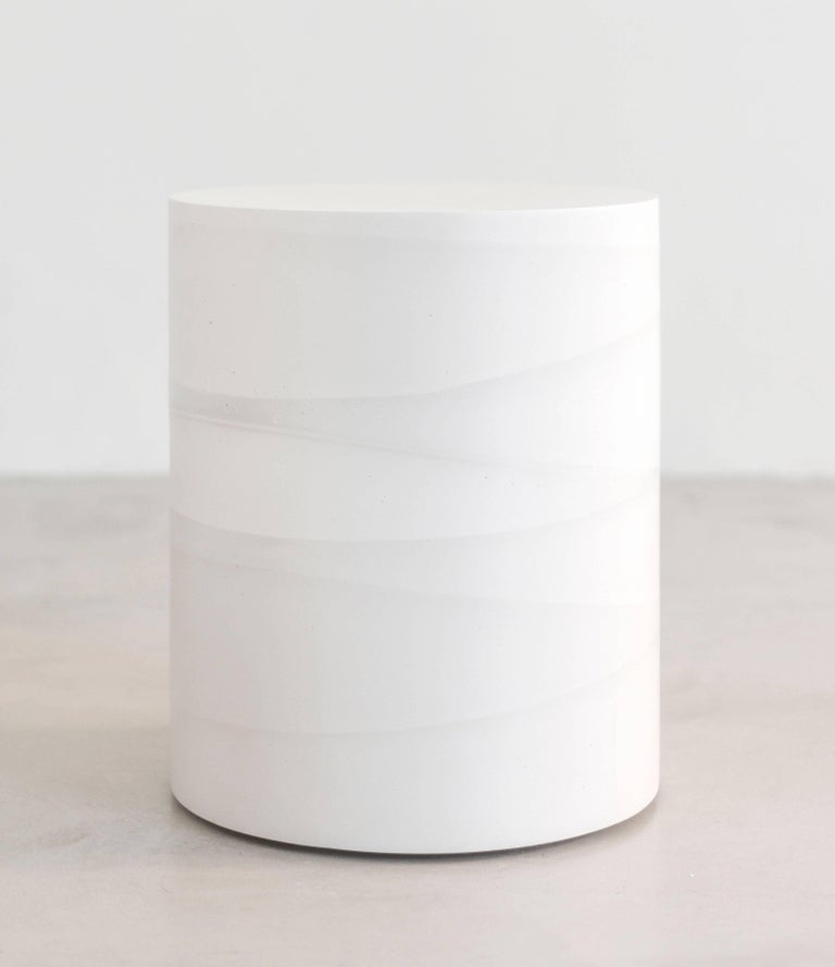 An exploration in the softness and subtly of the materials, the made-to-order drum has a hollow cavity and is cast entirely from hand-dyed cement. Poured in individual hand-dyed layers of white cement, the simple geometric form creates a light ombre