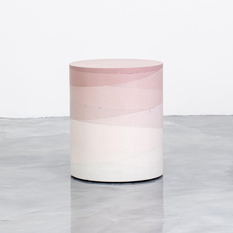 An exploration in the softness and subtly of the materials, the made-to-order drum has a hollow cavity and is cast entirely from hand-dyed cement. Poured in individual hand-dyed layers, starting from the base color blush and fading to white, the