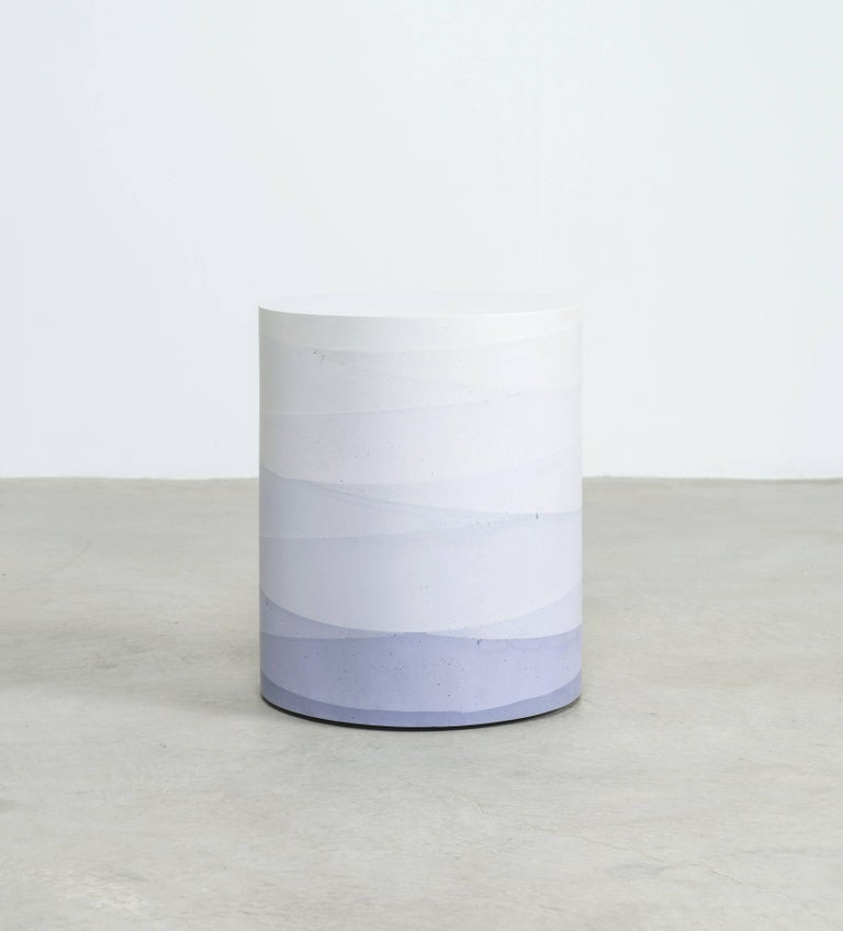 An exploration in the softness and subtly of the materials, the made-to-order drum has a hollow cavity and is cast entirely from hand-dyed cement. Poured in individual hand-dyed layers, starting from the base color lavender and fading to white, the