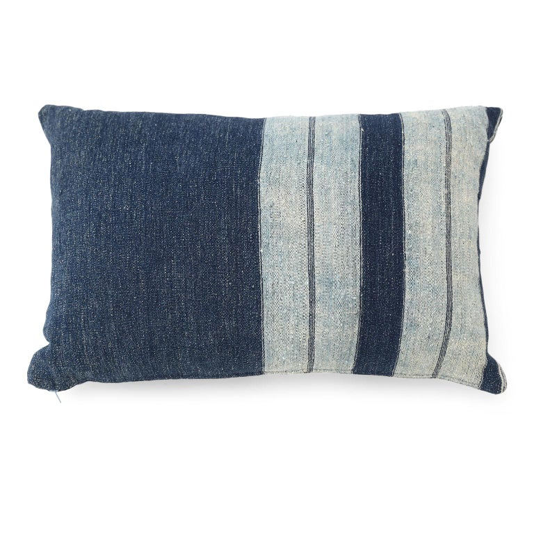 Faded indigo cushions made from antique handwoven slubby cotton fabric. Cushions include zip fasteners and feather inserts. Two available. Sold separately and priced $480 each.