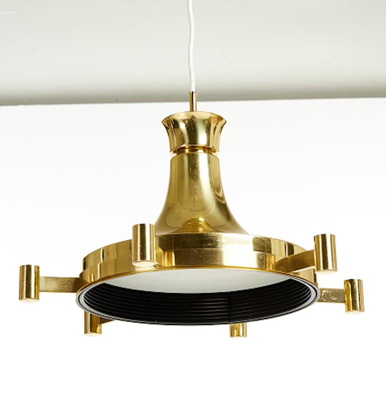 Modern Fagerhult ceiling fixture with six candle arms and brass frame, ceiling fixture with 6 candle arms for candles and also electrified (bulb in the interior), brass, diameter about 44 (17.5 inches), height about 28 cm (11 inches)- Height is
