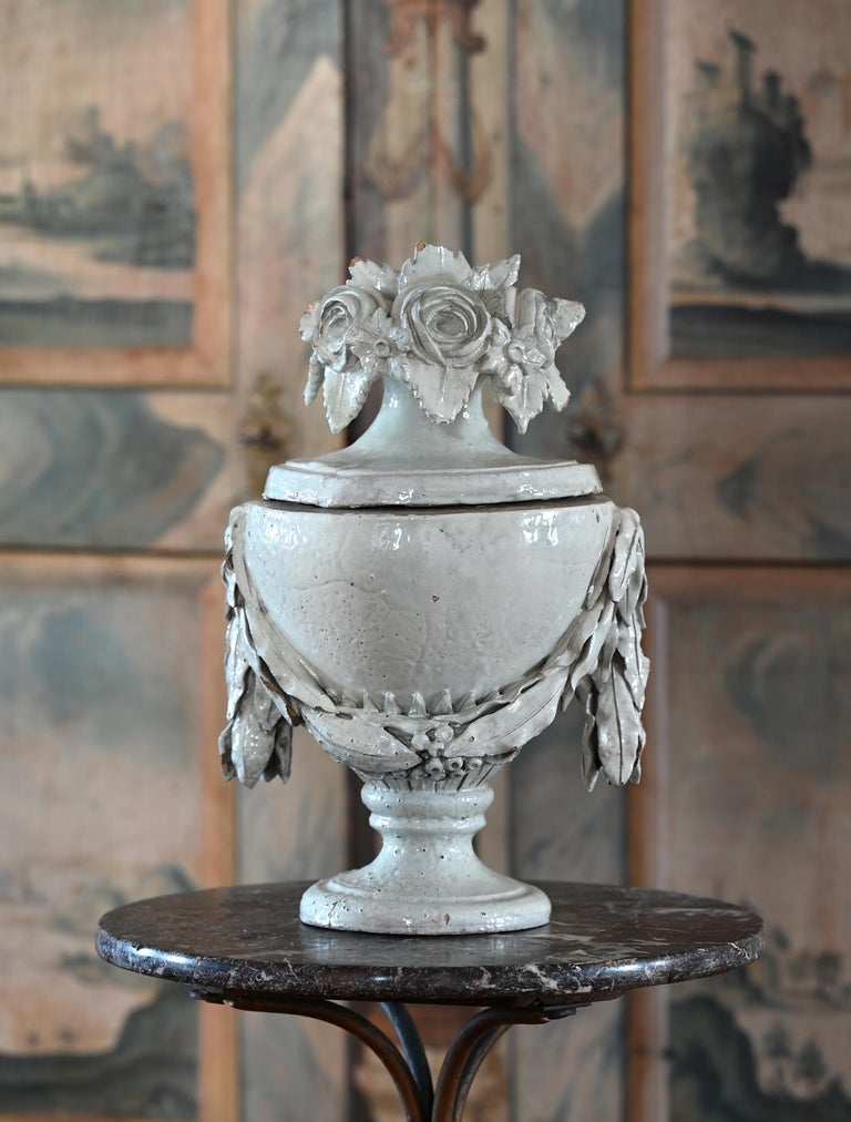 Special faience vase with lid, German, circa 1780. The rare vase is white glazed and very nicely shaped. The lid vase is an very decorative object.