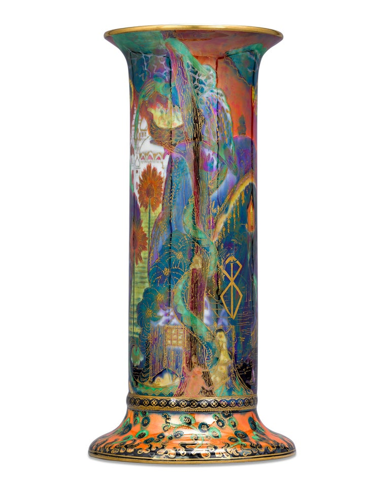 This superb Wedgwood porcelain pillar vase is an extraordinary example of the company's magnificent Fairyland Lustre line. Exhibiting fiery colors and scenes from a fantastical world, Fairyland Lustre pieces are among the most coveted Wedgwood