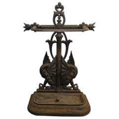 Falkirk, an Aesthetic Movement Cast Iron Stick Stand with Mythical Dragons