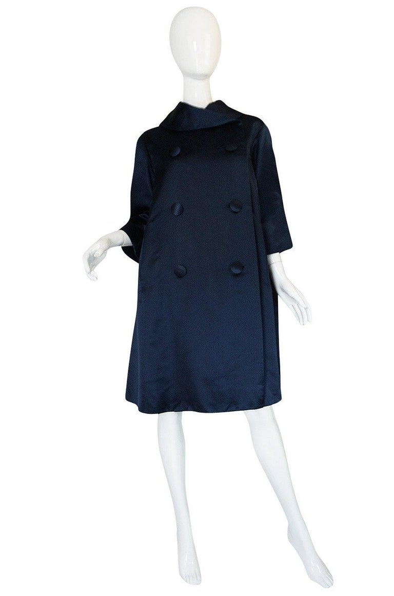 This Haute Couture evening coat is extraordinary. Yves Saint Laurent only created six Haute Couture collections for the House of Dior so pieces by him are very special and rare. Fall 1958 was his second collection for the house and this collection