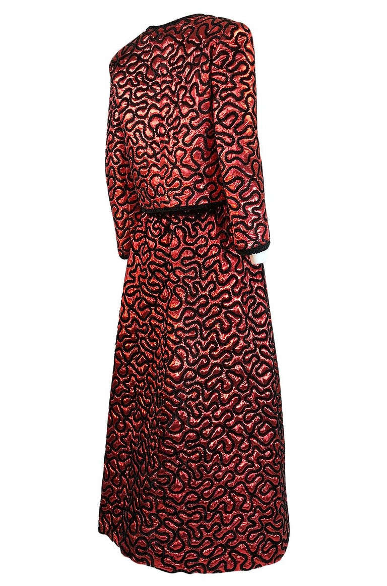Without doubt this is truly an exceptional piece of vintage Chanel and a rare find. It is a wonderful example of the work that Chanel was creating during this time period. Both pieces are made from a of a metallic red silk lurex fabric that is very