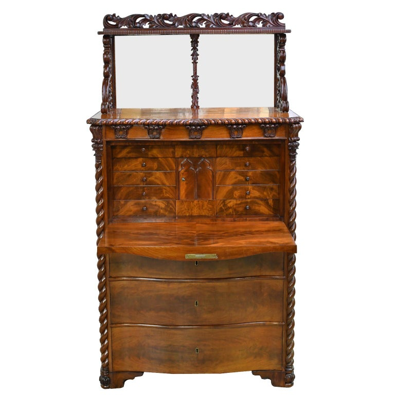 A very lovely secretary with serpentine front in beautiful West Indies/ Cuban mahogany attributable to Danish architect and painter, Gustav Friederich von Hetsch (1788-1864). A mirrored backsplash with elaborate and well-articulated pierced foliate