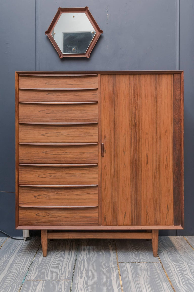 High quality design and construction tall dresser by Falster, Denmark. Comprising eight drawers with a tambor door concealing nine interior drawers. In good vintage condition with age appropriate wear and use.