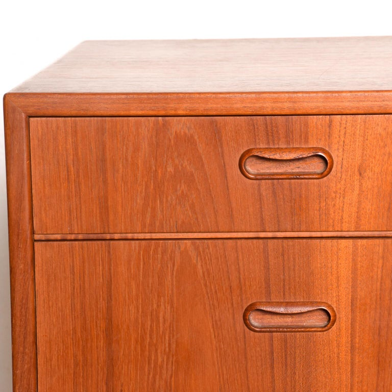 For your consideration: Highboy dresser-chest of drawers made in Denmark by FALSTER. Constructed with teak wood. All drawers are constructed with double dovetail joints and open-close with ease. Stamped with FALSTER label in the top drawer. The
