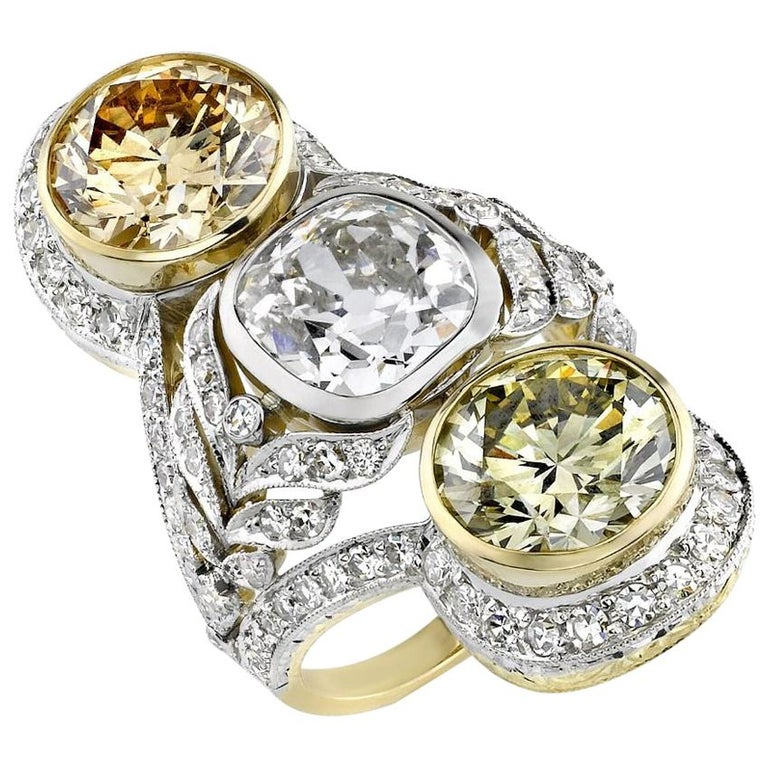 White- and colored-diamond, platinum and gold three-stone ring, 2018