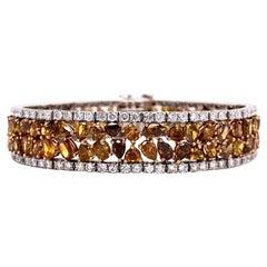 Fancy Color Natural Diamond Statement Bracelet with White Diamond Boarder