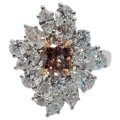 Fancy Deep Brown Pink Radiant Diamond and White Diamond Ring in Platinum and 18k