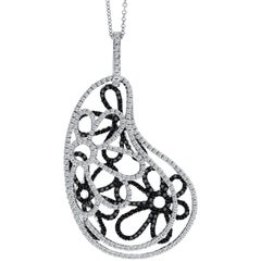 Fancy floral pendant in 18k white gold with 1.81 carat black and white diamonds