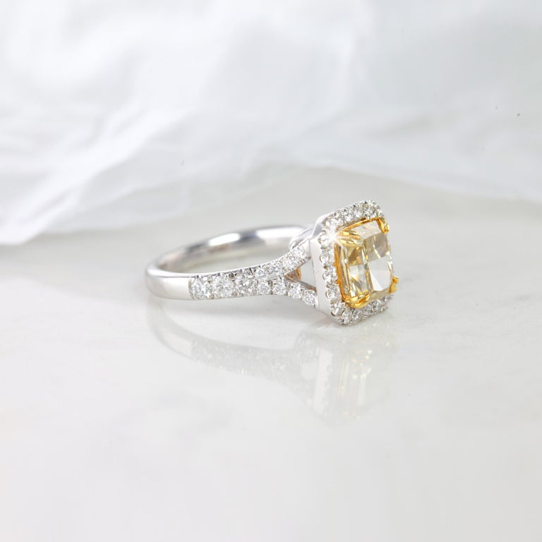 Gold metal: 18k White Gold Diamond Shape: Radiant Cut Main Stone: 1.89 Carats Side Stones: 1.25 Carats Total Carat Weight: Carats Color:  Fancy Intense Brownish Yellow  Clarity: VS2 Comments: Avangarde Ring Cut: Excellent All products comes with