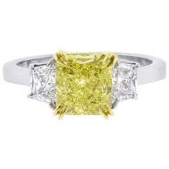 Fancy Intense Yellow 1.74 Carat Radiant Diamond Three-Stone Ring from Pampillona