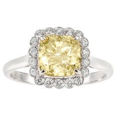 Fancy Intense Yellow Cushion Cut Diamond in Diamond Scalloped Cluster Ring 18ct